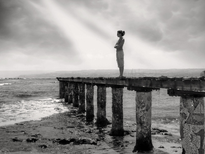 Woman-standing-by-sea